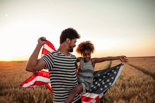 Celebrating independence day with my little girl ! Father and daughter holding American flag happy 4th of july photos stock pictures, royalty-free photos & images