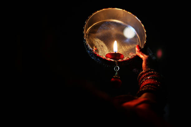 Celebrating Karva Chauth at night stock photo