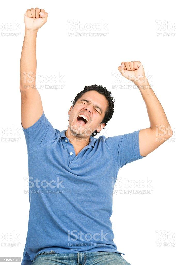 Celebrating Latino Man Arms Raised Eyes Closed stock photo