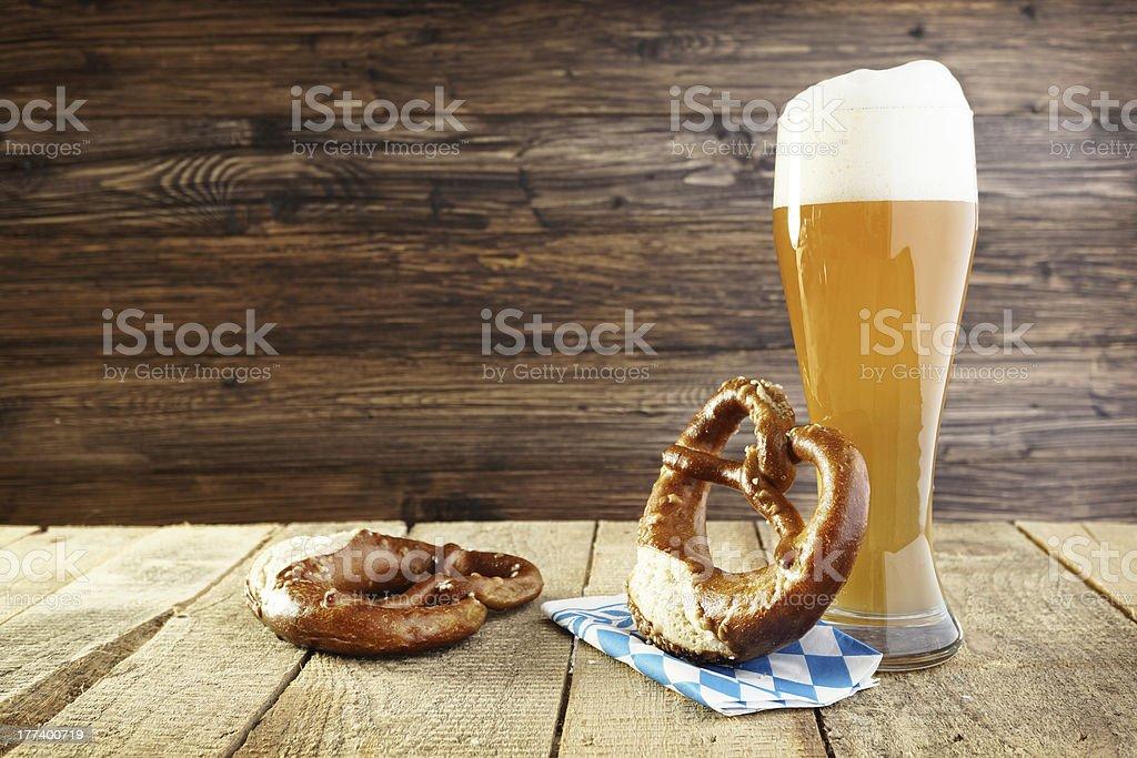 Celebrating Oktoberfest beer and a pretzel stock photo