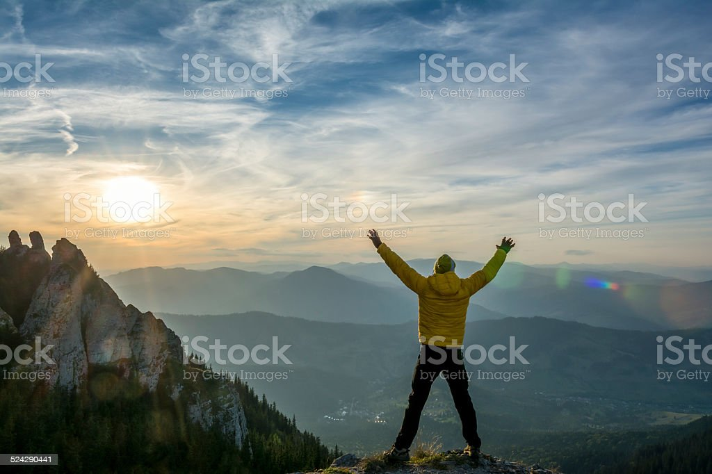 celebrating success in the sunset stock photo