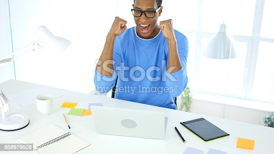 888751614 istock photo Celebrating Success while Working on Laptop, Excitement 858979526