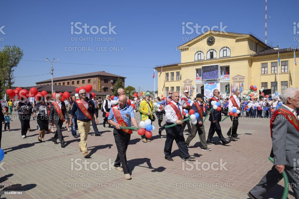Celebrating the first of May, the day of spring and work. May Day parade on the Theater Square in the city of Slavyansk-on-Kuban. stock photo