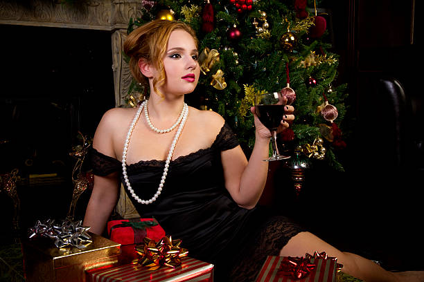 celebrating the holidays - mini dress stock photos and pictures