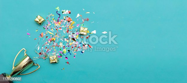 istock Celebrating the success that has happened, Gold trophy placed on a blue background. 1127290502