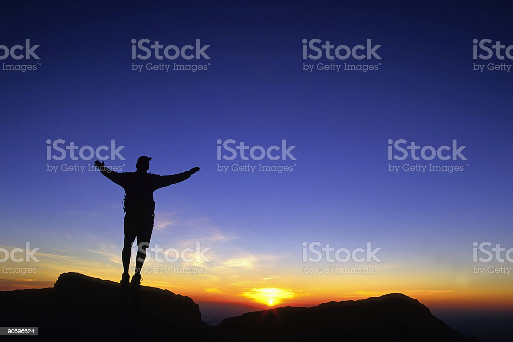 celebrating the sunrise sky (man silhouette with arms spread wide)! stock photo
