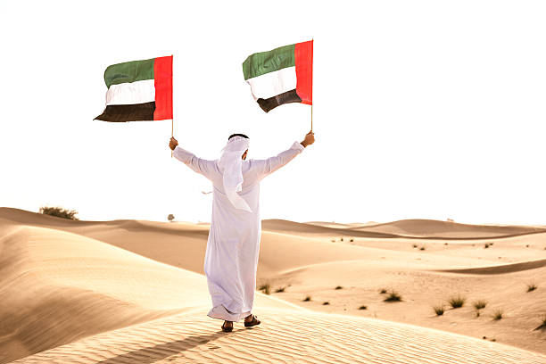 celebrating the uae national day on the desert - uae flag stok fotoğraflar ve resimler