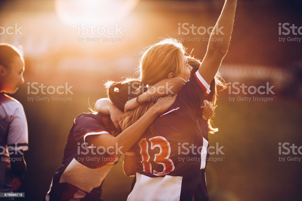 Celebrating the victory after soccer match! stock photo
