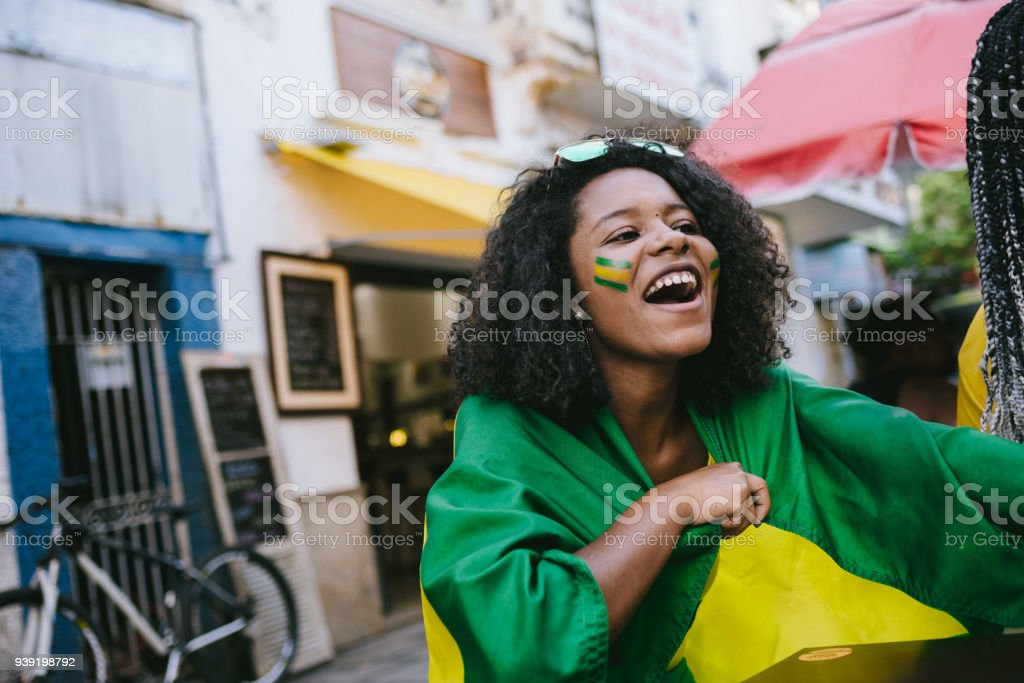 Celebrating the victory in a street bar stock photo