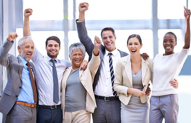 Celebrating their success stock photo
