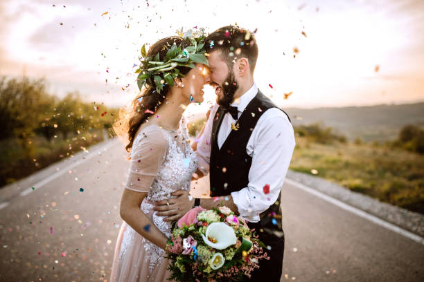 Celebrating Their Wedding With Style Wedding couple in love, confetti honeymoon stock pictures, royalty-free photos & images