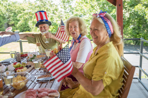 Celebrating  together Senior friends celebrating US Independence Day 4th of july senior citizen stock pictures, royalty-free photos & images