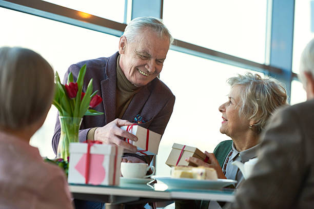 celebrating valentines day with friends - senior valentine stock photos and pictures