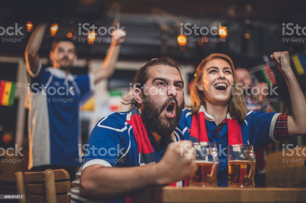 Celebrating victory with friends stock photo