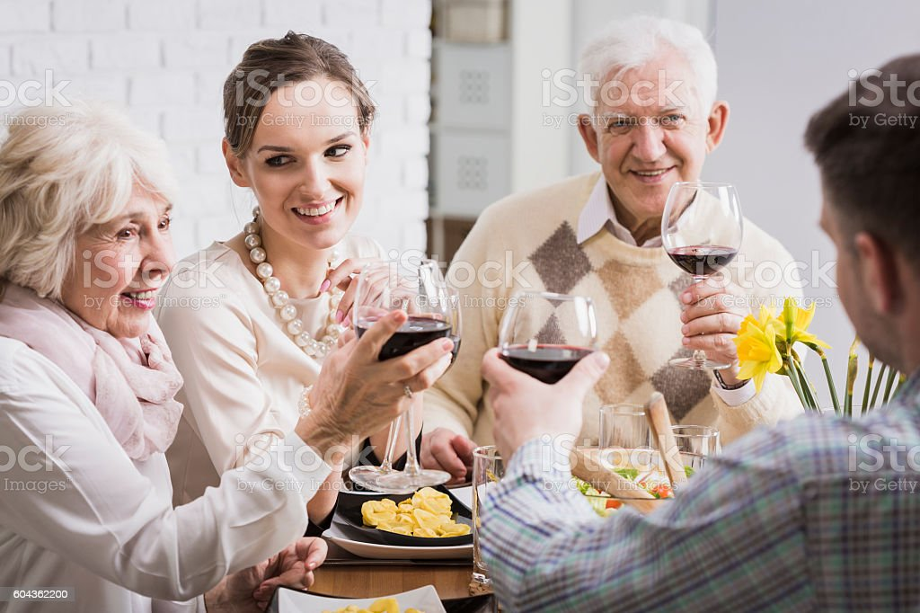 Celebrating with a glass of wine this wonderful moment stock photo