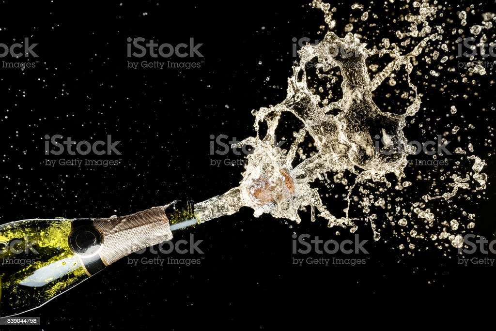 Celebration and holiday theme. Champagne splashes on black background stock photo