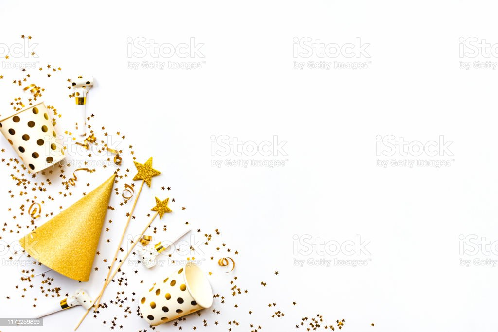 Celebration background - party accessories in golden colors. Copy...