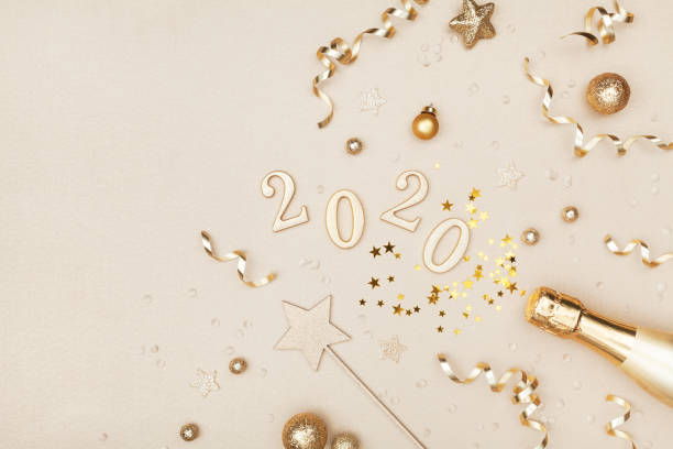 celebration christmas and new year background with golden champagne bottle, holiday decoration, confetti stars and 2020 numbers. - new years day stock pictures, royalty-free photos & images
