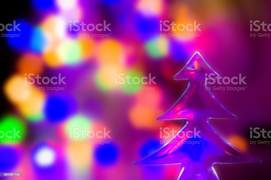 celebration concept christmas tree and abstract blurred lights on background blue purple - Orange Coloured Christmas Tree Decorations