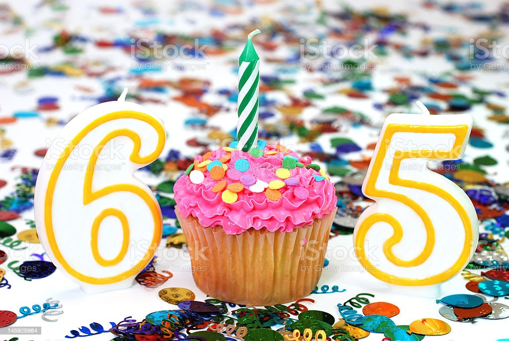 Celebration Cupcake with Candle - Number 65 stock photo