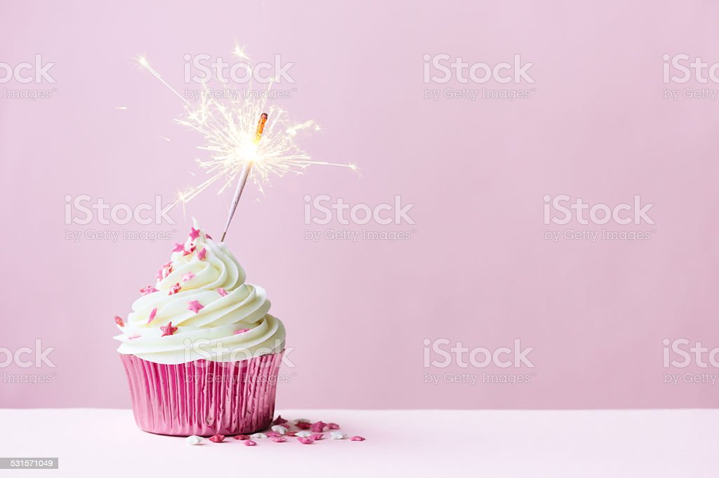 Celebration cupcake with sparkler stock photo