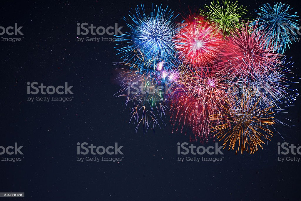 Celebration multicolored fireworks, copy space stock photo