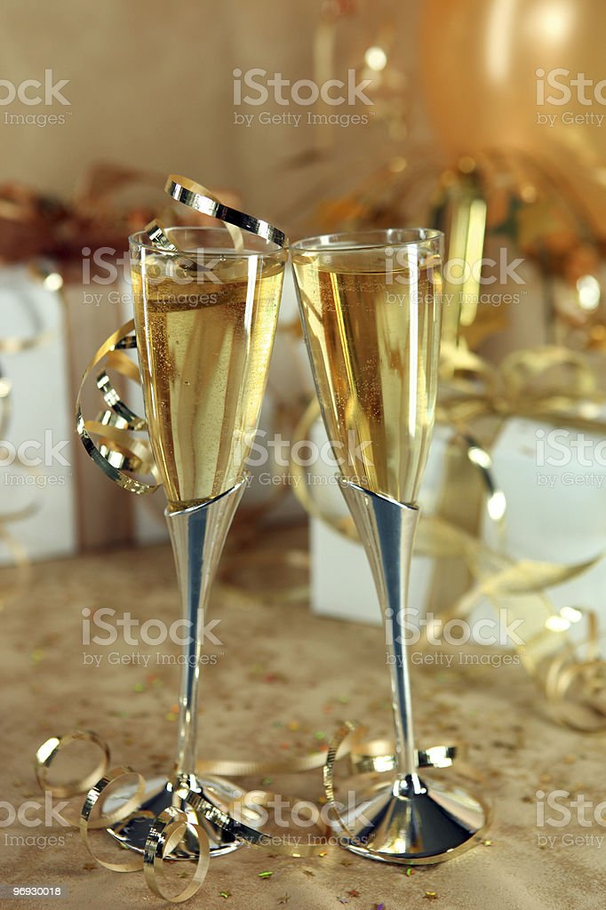 Celebration of an Event With Champagne Glasses and Gifts royalty-free stock photo
