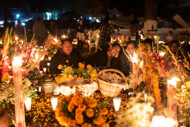Celebration of Mexican Day of the Dead at Tzintzuntzan Cemetery in the Pátzcuaro Region of Michoacán State. stock photo