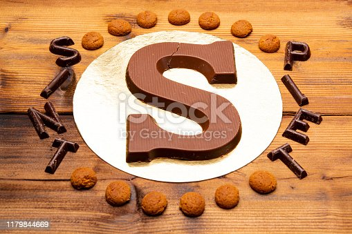 Celebration of Saint Nicholas, patron saint of children in Netherlands, Belgium, Luxembourg and North of France in first week of December, chocolate letters S and names of Sint and Piet close up