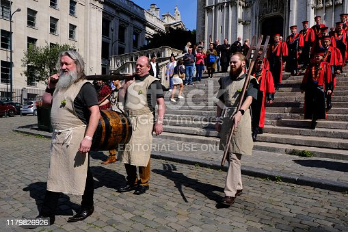 Bearers carry a barrel of beer on Grand Place ahead of a mass celebrating Saint-Arnould, patron saint of brewers at the Cathedral of St. Michael and St. Gudula in Brussels, Belgium on Sep. 6, 2019.