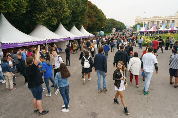 Celebration of the Day of the Higher School of Economics in city park Moscow, Russia - September 5, 2019: People walking in the Gorky Park in the autumn day. Celebration of the Day of Higher School of Economics college fair stock pictures, royalty-free photos & images