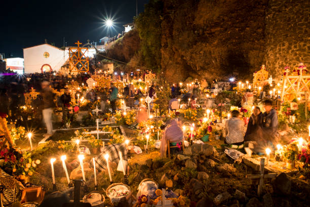 Celebration of the Mexican Day of the Dead at Janitzio Island Cemetery in the Patzcuaro region of Michoacán State. stock photo