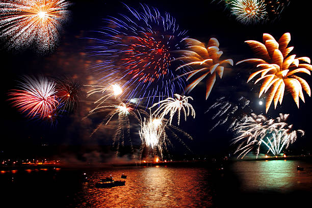 celebration of the new year, firework over  sea stock photo