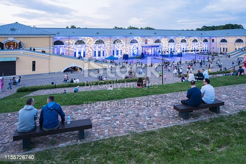 Daugavpils, Latvia - June 7, 2019: Mark Rothko center lit up in colorful lights as per celebration of the towns yearly festival. People are gathering in front of the building In anticipation of the yearly concert