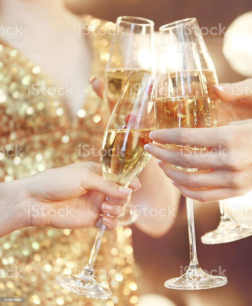 Celebration. People holding glasses of champagne making a toast stock photo