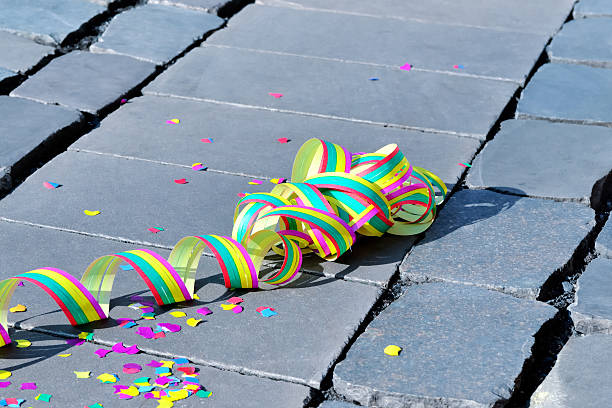 Celebration Celebration - streamer on the ground - symbol for celebration and party prom night stock pictures, royalty-free photos & images
