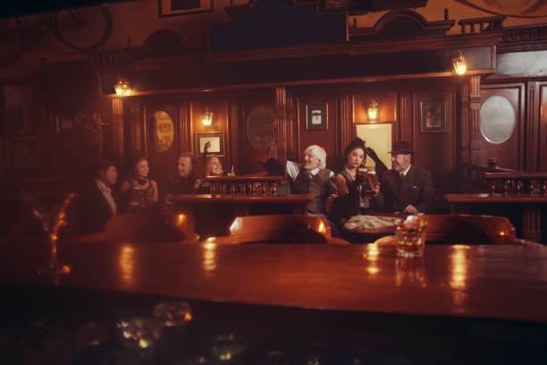 Celebration retro pub oldfashioned group of senior men and young picture id925619134?b=1&k=6&m=925619134&s=612x612&w=0&h=x4m9e b98g0y ksofu8kztiialjpccfgrsxdpse 4kw=