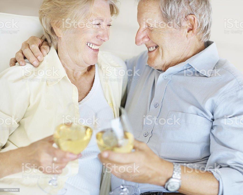 Celebration - Senior couple drinking white wine together royalty-free stock photo