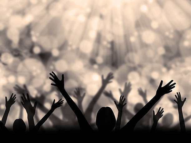 celebration silhouette - praise and worship stock photos and pictures
