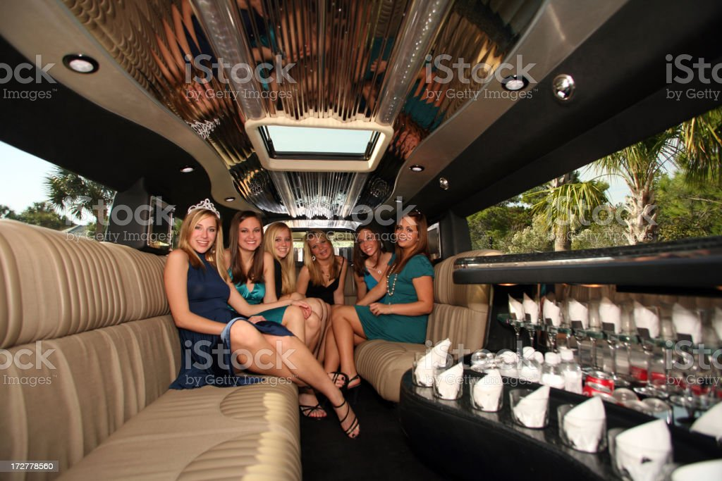 Celebration Sweet 16 Birthday Party in Limousine with five girls stock photo