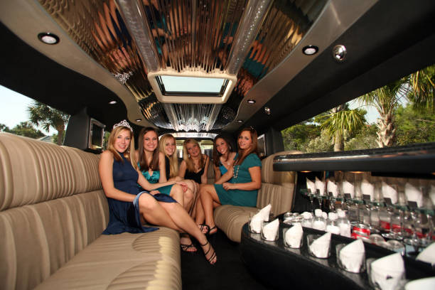 celebration sweet 16 birthday party in limousine with five girls - prom stock photos and pictures