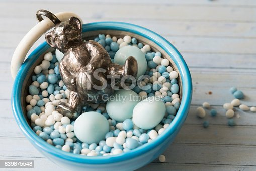 istock celebration the birth of a sun with dutch blue sugared aniseed balls and a silver bear rattle 839875548
