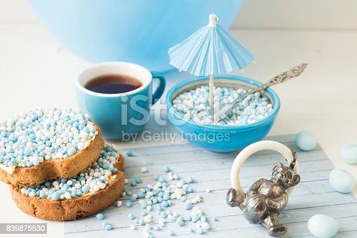 istock celebration the birth of a sun with dutch crisp bakes with blue sugared aniseed balls, against white background 839875530
