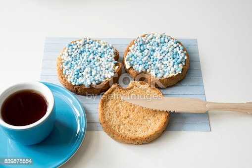 istock celebration the birth of a sun with dutch crisp bakes with blue sugared aniseed balls, against white background 839875554