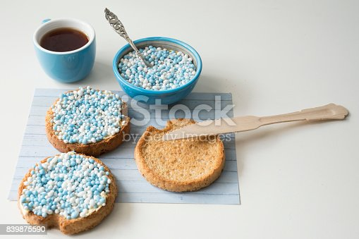 istock celebration the birth of a sun with dutch crisp bakes with blue sugared aniseed balls, against white background 839875590