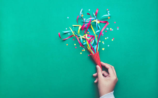 celebration,party concepts.hand holding colorful confetti,streamers. - celebration stock pictures, royalty-free photos & images