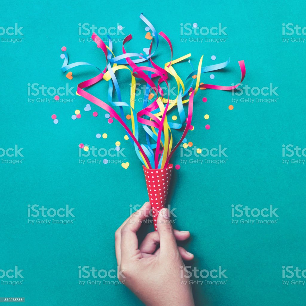Celebration,party concepts.hand holding colorful confetti,streamers. stock photo