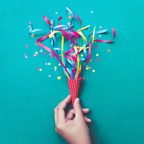 Celebration,party concepts.hand holding colorful confetti,streamers. Celebration,party backgrounds concepts ideas with hand holding colorful confetti,streamers.Flat lay design carnival celebration event stock pictures, royalty-free photos & images