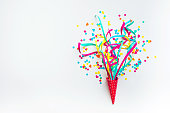 istock Celebration,party with colorful confetti,streamers on white. 871727100