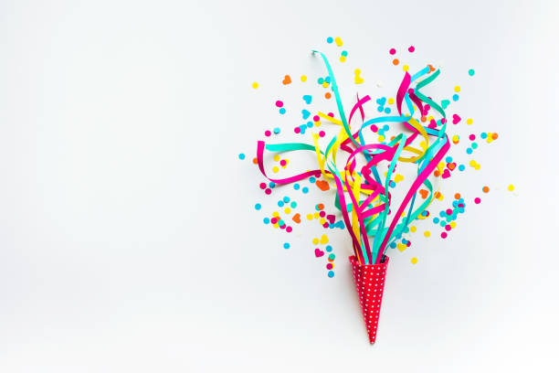 celebration,party with colorful confetti,streamers on white. - celebration stock pictures, royalty-free photos & images